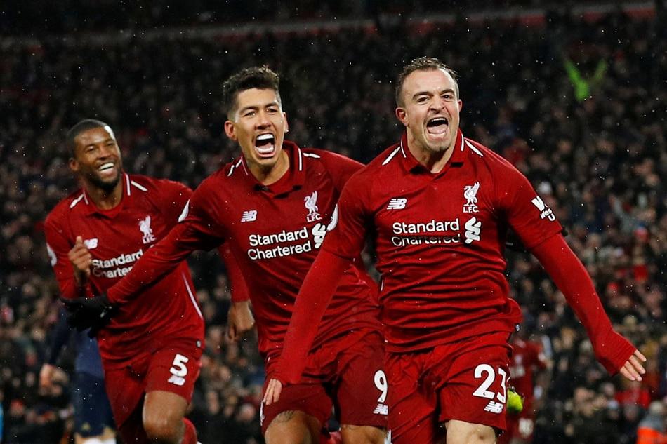 f7f2d9db4 Liverpool s Xherdan Shaqiri celebrates scoring their third goal with  Roberto Firmino and Georginio Wijnaldum. Phil Noble