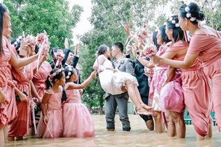 LOOK: Couple pushes through with wedding in flooded Capiz church
