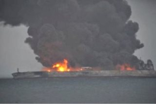 Rescue crews wrestle to tame China oil tanker fire