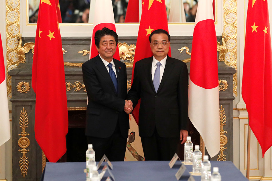 Li receives warm welcome to Japan from Abe