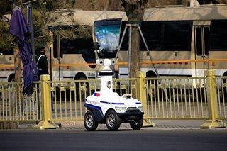 At Beijing security fair, an arms race for surveillance tech