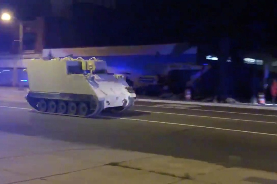 Suspect surrenders following chase involving Armored Personnel Carrier