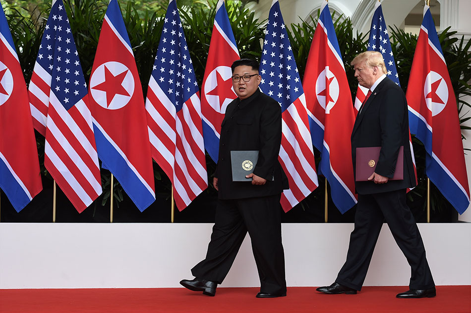 Fox News host apologizes for calling Trump and Kim 'two dictators'