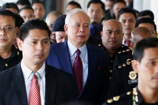From highest office to high court: Malaysia gripped by Najib's downfall