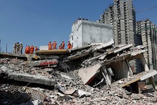 At least 2 dead in building collapse outside Indian capital