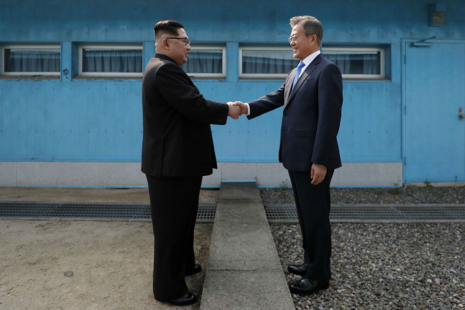North's media say Kim vows nuclear-free Korea amid standoff