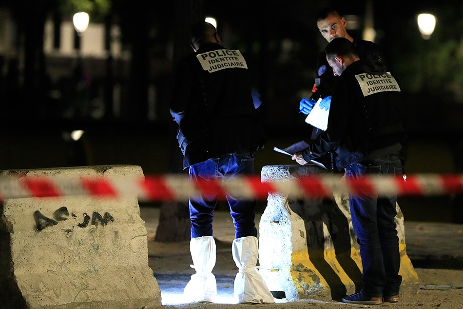 Knifeman is arrested after injuring seven people in rampage through central Paris