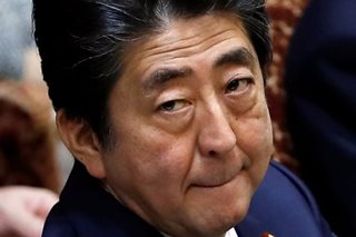 Turning to diplomacy, Japan's Abe hopes to change channel from scandal woes
