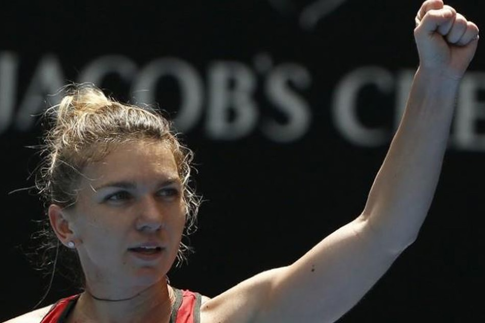 Tennis brave halep wins marathon to reach fourth round abs cbn news simona halep of romania celebrates winning against lauren davis of the us reutersthomas peter thecheapjerseys Images