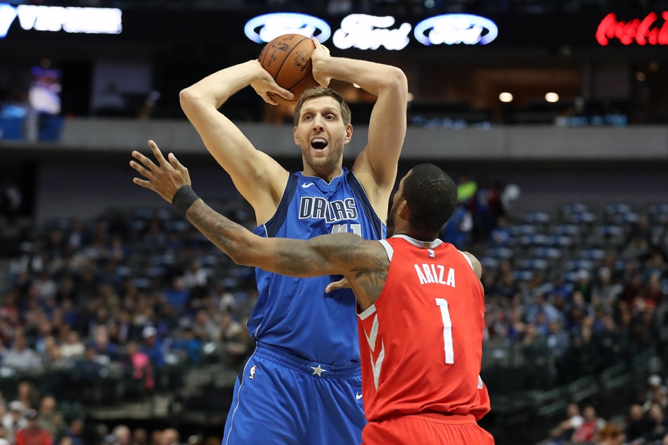 17b972f79 Dallas Mavericks forward Dirk Nowitzki (41) looks to pass against Houston  Rockets forward Trevor Ariza (1) at American Airlines Center in this file  photo.