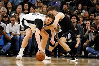 Spurs top Kings to clinch 21st consecutive playoff berth
