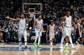 Butler helps Wolves top Nuggets, claim last playoff spot