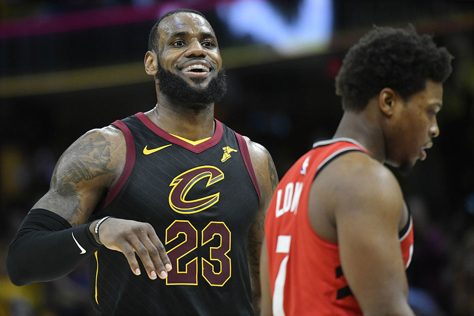 ed01b7ee265 Cleveland Cavaliers forward LeBron James (23) reacts beside Toronto Raptors  guard Kyle Lowry (7) in this file photo. David Richard