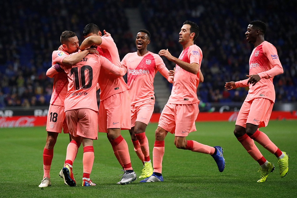 Barcelona's Lionel Messi celebrates scoring their first goal with team mates. Albert Gea Reuters