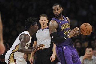 NBA: Ailing James still racks up triple-double in Lakers' win