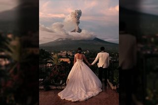 Love amid calamity: Newlyweds photographed before erupting Mayon Volcano