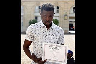 French family of rescued boy thanks hero Malian 'Spiderman'