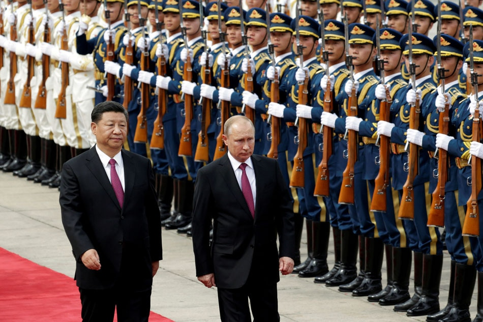 Xi Jinping welcomes Putin