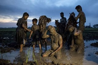 IN PHOTOS: Devotees slather themselves in soil