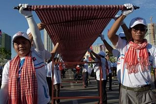 Cambodia earns Guinness Record for longest woven scarf