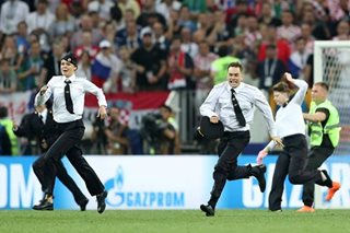 Anti-Kremlin protesters invade pitch during World Cup final
