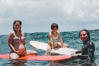 Surfer mama: Andi Eigenmann hits the waves with baby bump
