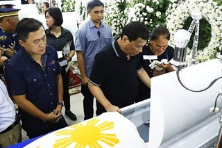 Duterte visits wake of cops allegedly killed by NPA