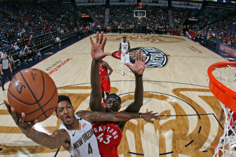 Elfrid Payton  4 of the New Orleans Pelicans drives to the basket against  the Toronto Raptors during a pre-season game on October 11 eb8bdab25