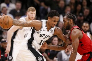 DeRozan shoots, passes Spurs past feisty Cavaliers