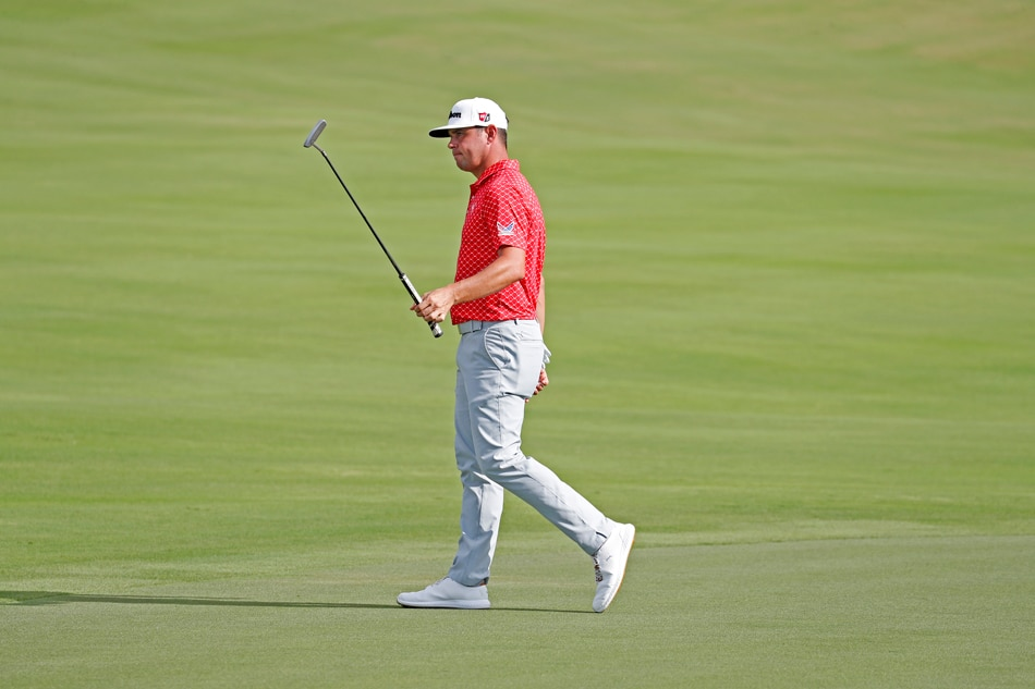 Rory McIlroy in hot pursuit in Hawaii as Gary Woodland maintains lead