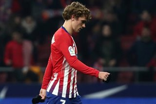 Atletico crash out of Copa del Rey but Real, Sevilla sneak through