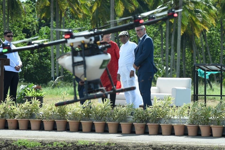 Sri Lanka president Sirisena checks IRRI's drone seeder