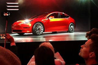Tesla says its $35,000 electric car ready to roll