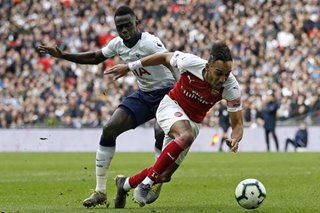 Football: Spurs draw with Arsenal, Man City go back on top