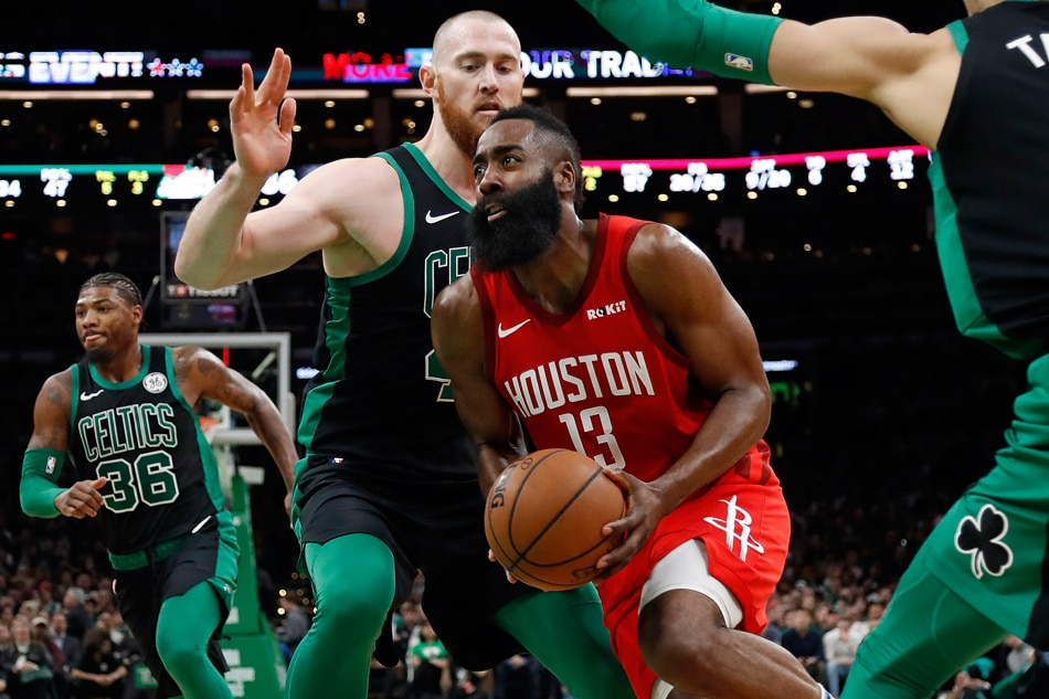 20a09b0c099 Houston Rockets guard James Harden (13) drives past Boston Celtics center  Aron Baynes (46) during the first half at TD Garden. Winslow Townson