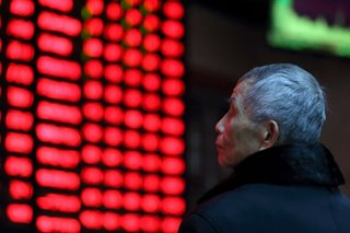 Asian shares retreat, China cuts growth target