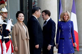 France signs deals with China