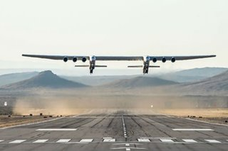 LOOK: World's largest plane makes first test flight