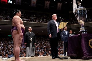Sumo wrestlers steal Trump thunder in Japan visit