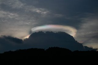 Rainbow halo over Angat reservoir