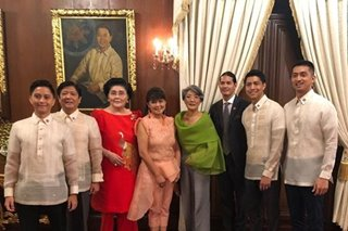 'Back in Malacanang': Marcoses all smiles while posing by late dictator's portrait