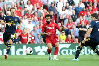 Football: Liverpool keep perfect record, more penalty woe for United
