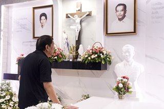 LOOK: Duterte visits parents' tomb ahead of All Saints Day