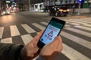 South Korea radar, thermal camera system warns 'smartphone zombies' of traffic