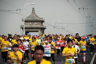Bikes, shortcuts, bibs for cash: China marathon cheats run rampant