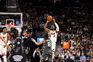 NBA: Miami holds on, snaps Spurs' win streak
