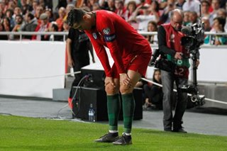 Football: Injured Ronaldo limps off in Portugal qualifier