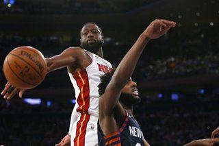 NBA: Heat top Knicks, cling to postseason berth