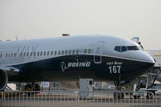 General Electric tops profit estimates, calls 737 MAX 'new risk'