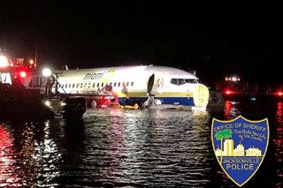 'Miracle' as passengers safe after plane skids into Florida river